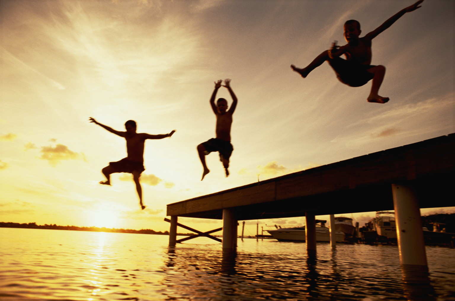 THREE CHILDREN JUMPING OFF DOCK IN SOUTH FLORIDA