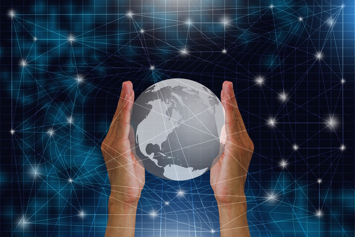 Man's hands holding globe with worldwide connection, digital communication technology concept