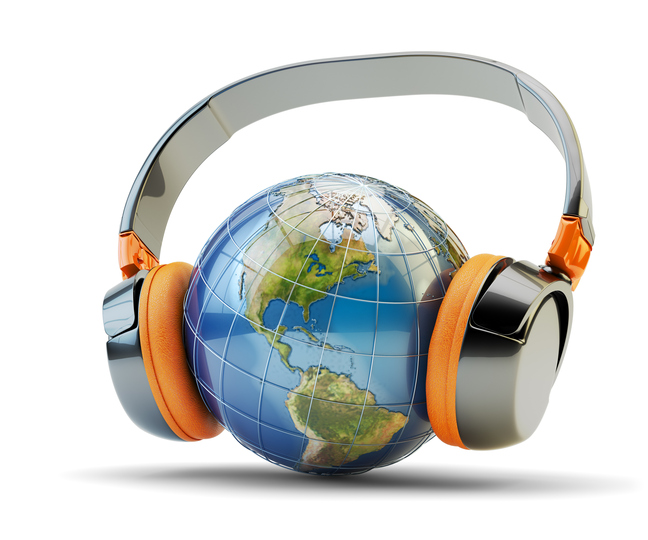 Planet Earth globe with modern black headphones isolated on white